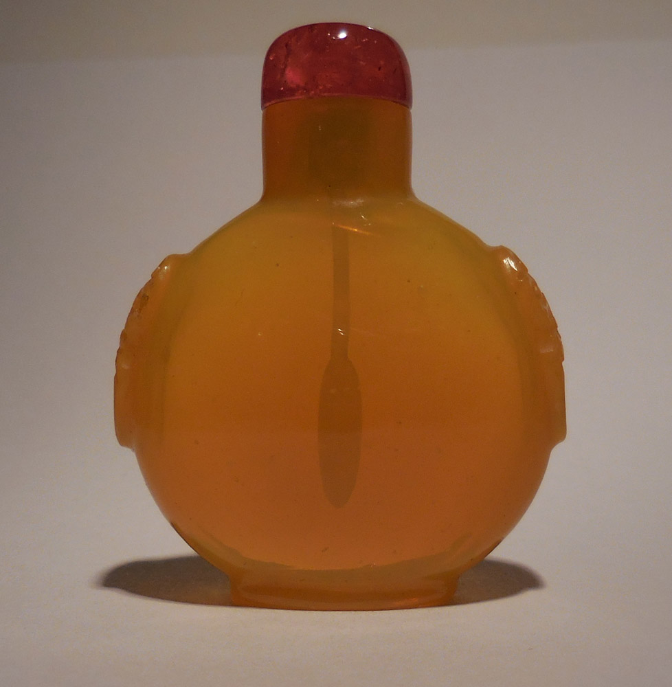 Translucent yellow glass snuff bottle